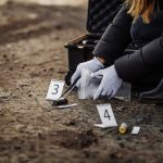 Woman collecting crime scene evidence